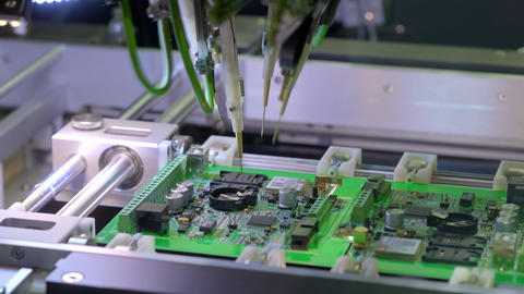 Electronic circuit board production. Automated Circut Board machine Produces Live Action