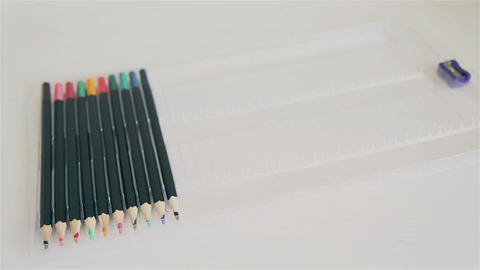 Men's hand sorts colored pencils in box HD Live-Action