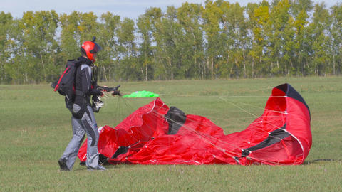 Skydiver parachute collapses after landing 001 Live Action