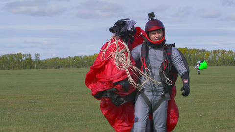 Skydiver parachute collapses after landing 003 Live Action
