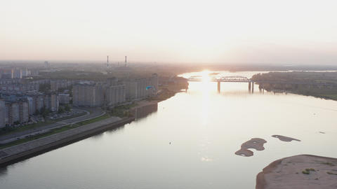 Parasail wing flying on golden sunset horizon landscape. Paraplane flying over river on city bridge Live Action