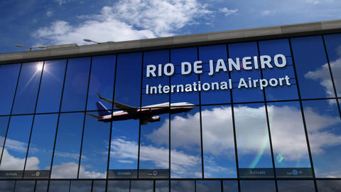 Airplane landing at Rio de Janeiro mirrored in terminal Live Action
