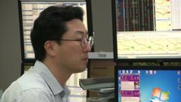 ASIAN TRADER DEALER AT KOREAN STOCK EXCHANGE TRADING Footage