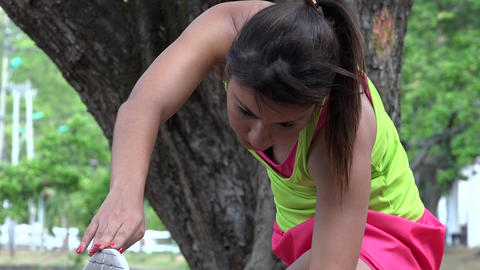 Fit Female Jogger Stretching Live Action