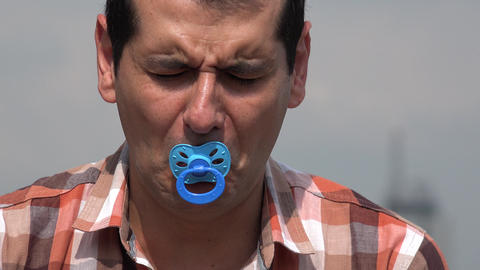 Adult Man Using Baby Pacifier Live Action