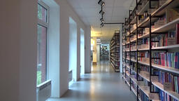 A hallway with bookshelves in the library Footage