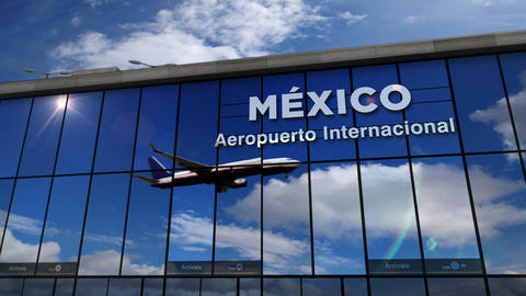 Airplane landing at Mexico mirrored in terminal Live Action