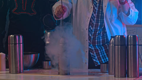 A scientist holding a rose in the thermos with liquid nitrogen Footage