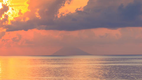 Stromboli volcano on sea horizon timelapse GIF