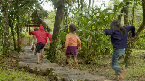 Indigenous People Running Barefoot On A Forest Path To Get To Their Village Live Action
