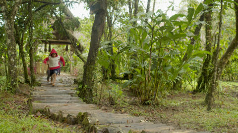 Indigenous People Running Barefoot On A Forest Path Outside Of Their Village Live Action