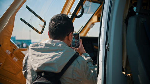An outdoors aircraft exhibition - a man taking a photo of… Stock Video Footage