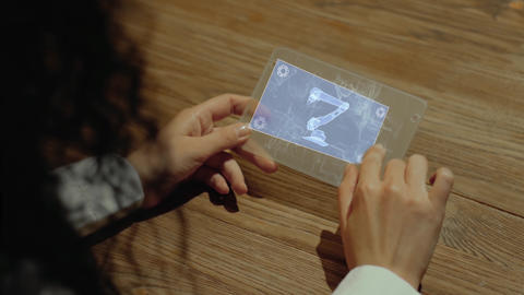 Hands hold tablet with robo hand Live Action