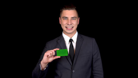 Young businessman presents a bank green card and shows…, Live Action