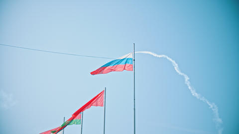 Flags of the world countries blowing in the wind - an airplane performing a show Footage