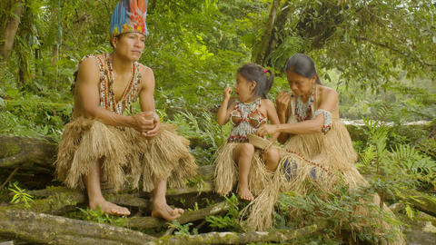 Indigenous Man Telling A Story To His Family At The Edge Of A River Footage