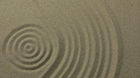 Panorama. Circles and curve lines on the sand. Texture of sand Live Action