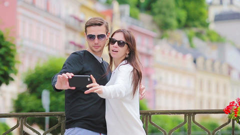 Romantic couple walking together and taking selfie in Europe. Happy lovers Live Action