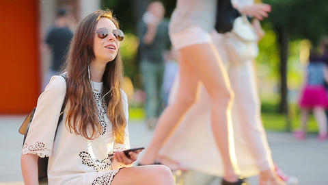 Young beautiful girl enjoy listening music and dancing outdoors. Beautiful Live Action