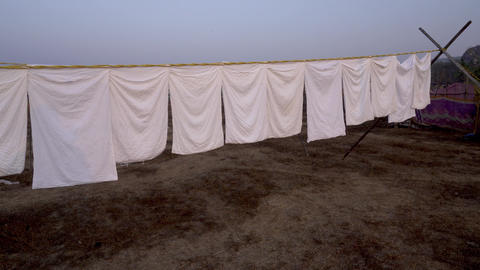 white bedding dries outdoors Footage