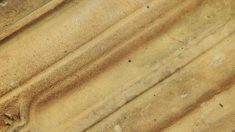 Rotation. Yellow roof tile texture, macro close-up detailed, copy space Live Action
