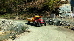NEPAL – MARCH 18 2016: Tractor rides mountain road. Himalayas HD video Footage