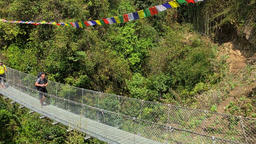 Hiker walking mountain suspension bridge take photo HD video Himalayas Nepal Footage