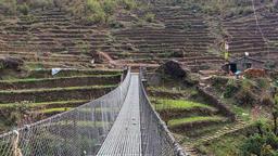 POV walking mountain suspension bridge. Himalayas Nepal farm HD video Footage