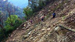 Hikers backpack cross mountain steep road. Himalayas Nepal HD video Footage