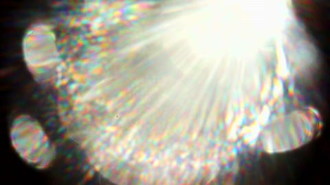 A multi-faceted lens flare full of lens detail and spectrums Footage