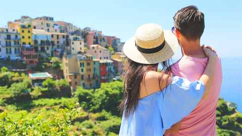 Couple in honeymoon with view of the old coastal town in Cinque Terre national Live Action