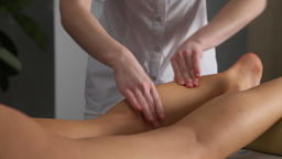 Beauty therapist massaging a a woman's massages legs and caviar Footage
