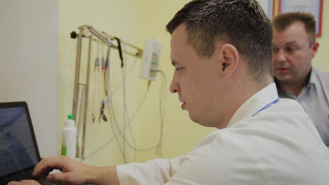 Male patient tells doctor his health complaints Footage