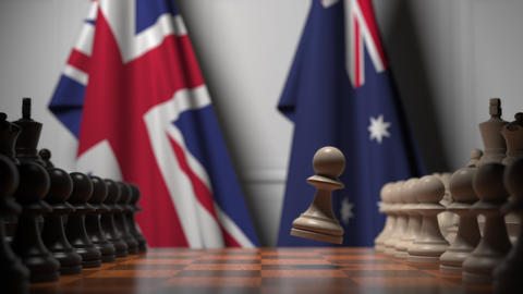 Chess game against flags of Great Britain and Australia. Political competition Live Action
