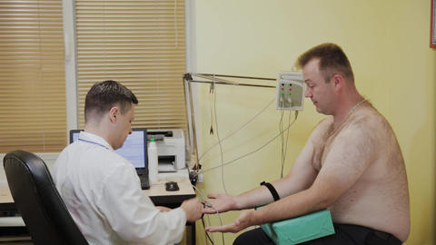 Male doctor examines a patient with a medical device Footage