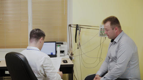 Male doctor gives the patient the results of the study Live Action
