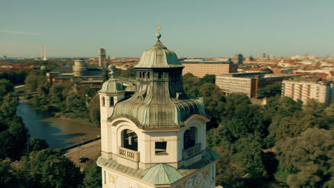 Aerial orbiting shot of the tower of historic Mullersches Volksbad public bath Footage