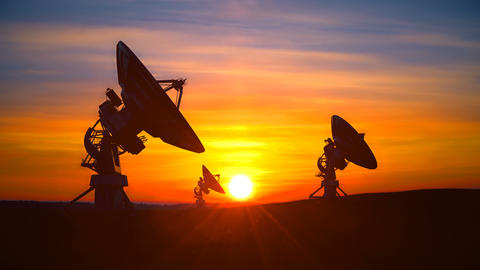 Three radio telescopes against scenic sunset exploring evening sky Animation