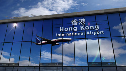 Airplane landing at Hong Kong mirrored in terminal Live Action