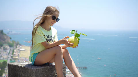 Big yellow lemon in hand in background of mediterranean sea and sky Footage