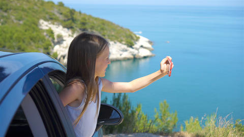Little girl on vacation travel by car. Summer holiday and car travel concept Live Action