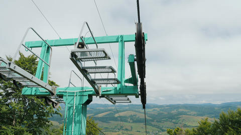 View of ski lift mechanism on top of support pillar Footage