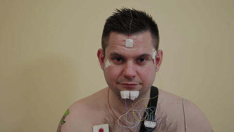 Male patient examining an organism with a device Footage