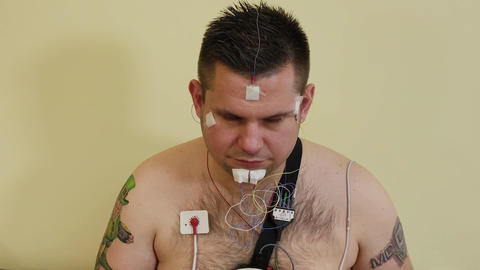 Male patient examining an organism with a device Live Action
