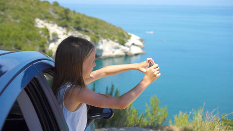 Little girl on vacation travel by car. Summer holiday and car travel concept Footage