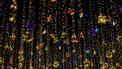 Colourful holidays garland against night sky Live Action