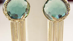 Jewellery.Close-up of the green diamond earrings.Shallow depth of field Live Action