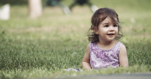 Cute baby girl exploring a park in late summer Live Action