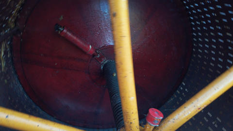 Grape press, large drum press crushing fruit, modern agriculture machinery Footage