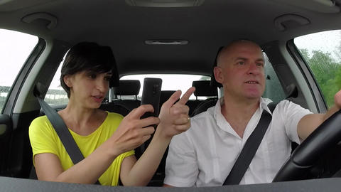 Couple Smiling In Car Playing Pokemon Go With Smartphone Footage